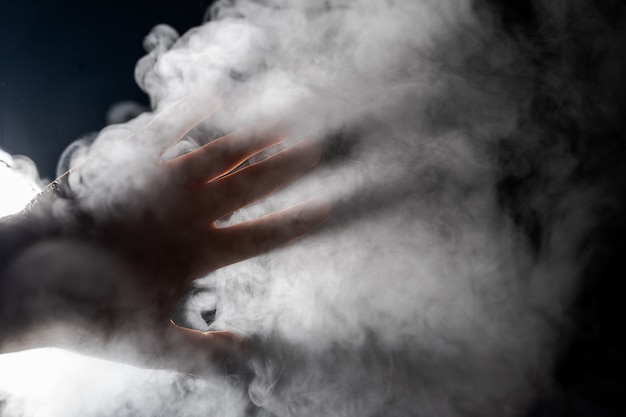 Hand on the background of steam.