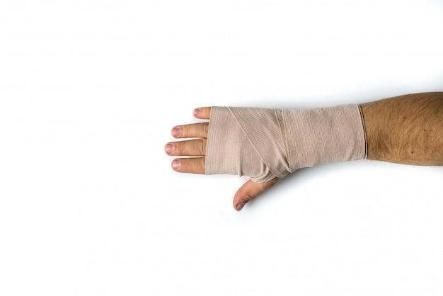 Hand bandaged of man on white isolated background