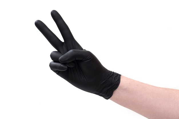Hand in black leather glove with key isolated