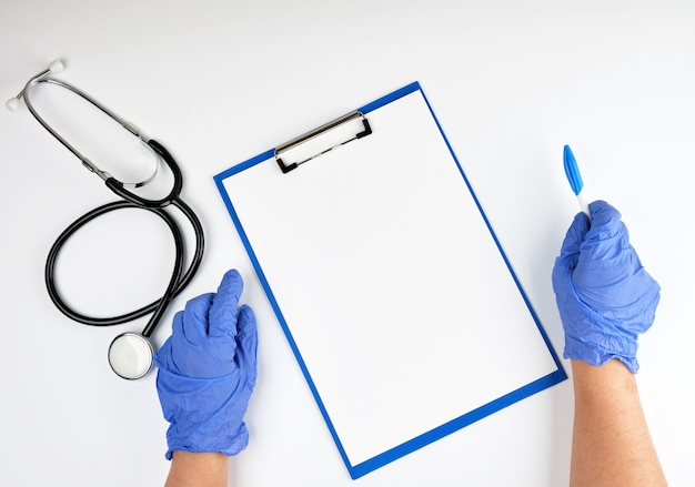 Hand in blue sterile gloves and medical stethoscope