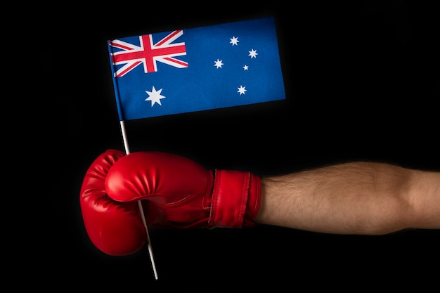 Hand in boxing glove holds the australian flag