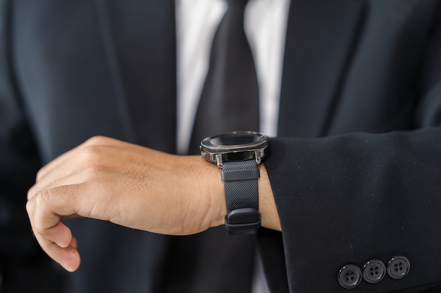 Hand of business man with smart watch