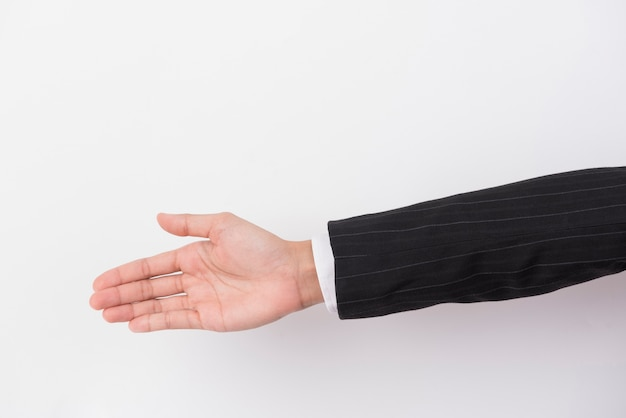 The hand of a businessman extends