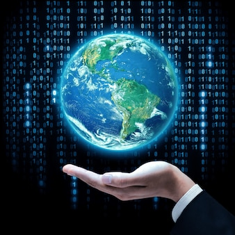 Hand of businessman holding earth planet. studio shot. elements of this image are furnished by nasa