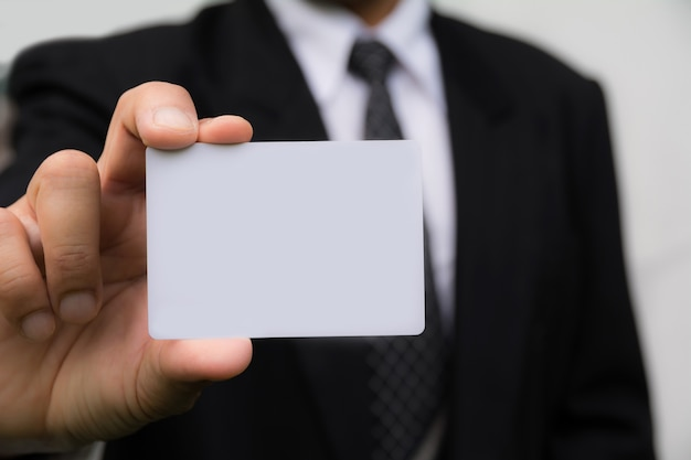 Hand of businessman holding the white card on white background.