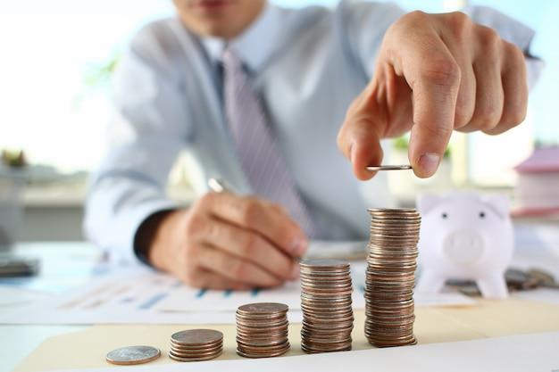 Hand businessman putting pin money