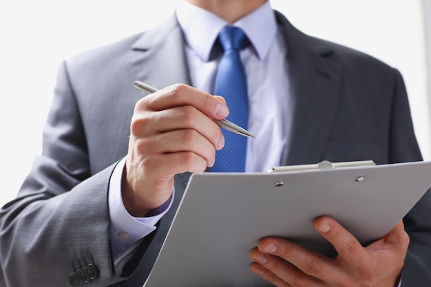Hand of businessman in suit filling