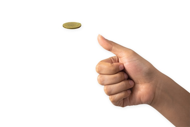 Hand of businessman tossing a golden coin isolated on white background