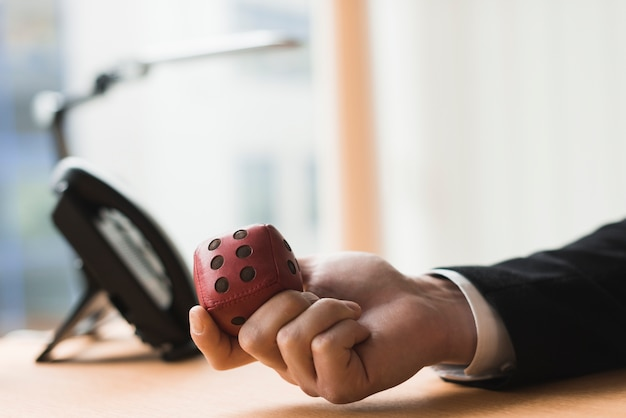 Hand of businessman with toy