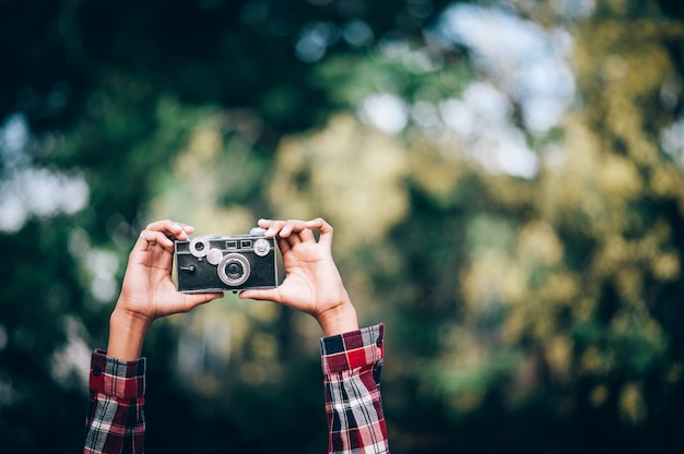 Hand and camera and travel