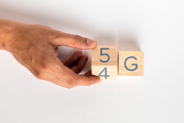 Hand changing 4g to 5g on cubes
