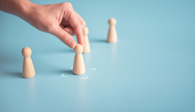 Hand choose the best person from group of human for the job vacancy