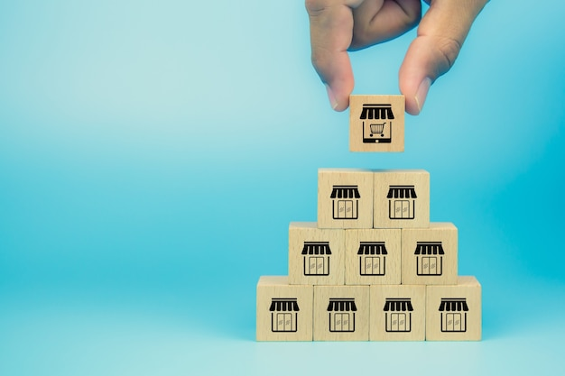 Hand choose wooden block stack with franchise business e-commerce store.