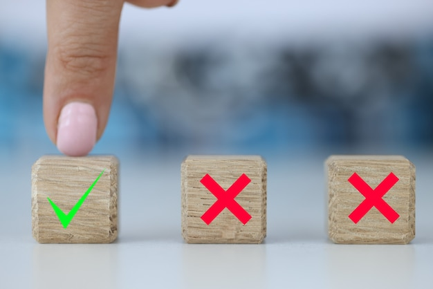 Hand chooses between two dice with yes and no