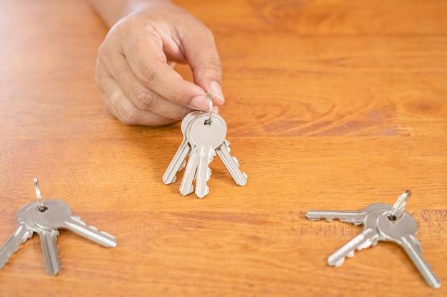 Hand choosing set of home silver key