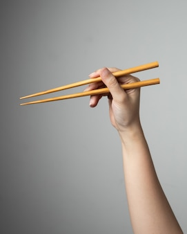Hand chopstick asian japanese chinese food style traditional