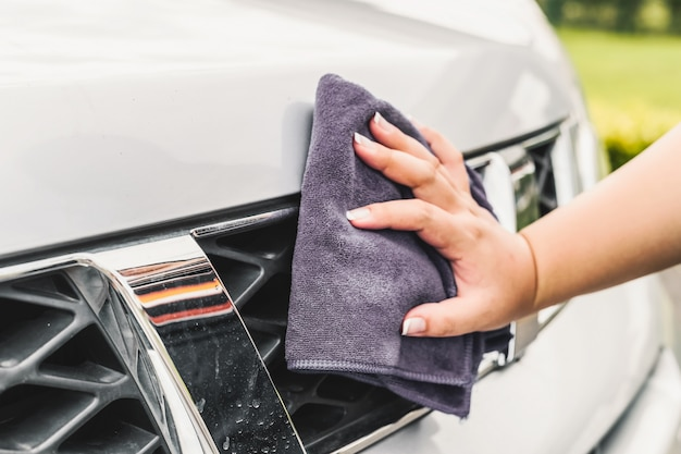 Hand cleaning a car close