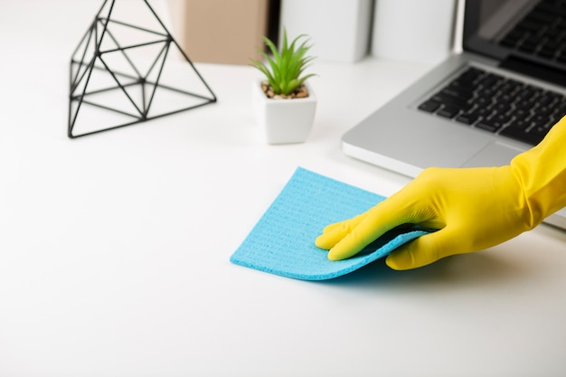 Hand cleaning office desk