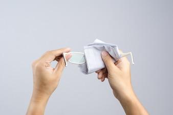 Hand cleaning the lenses of eyesight glasses