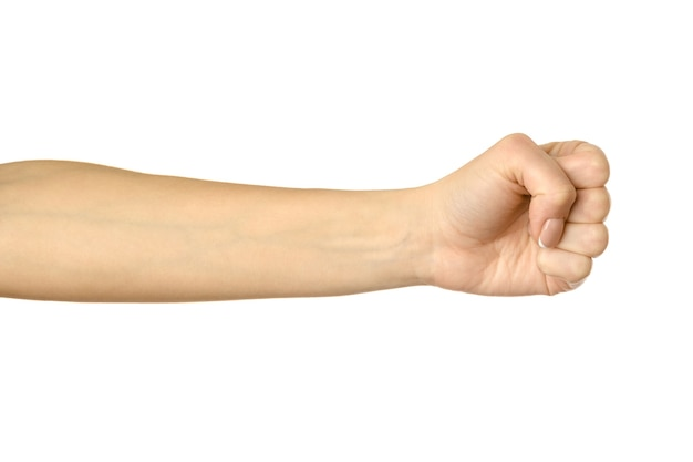 Hand clenched in a fist. horizontal image. woman hand with french manicure gesturing isolated on white background. part of series