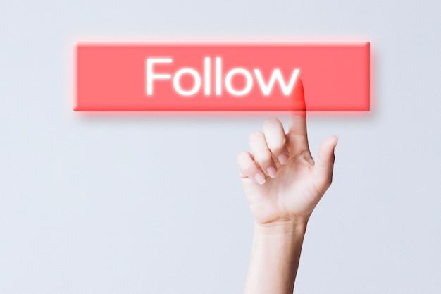 Hand clicking follow button on social media