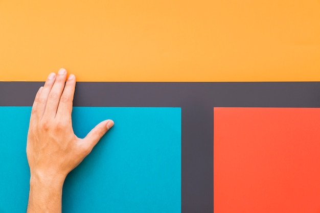 Hand on colorful background