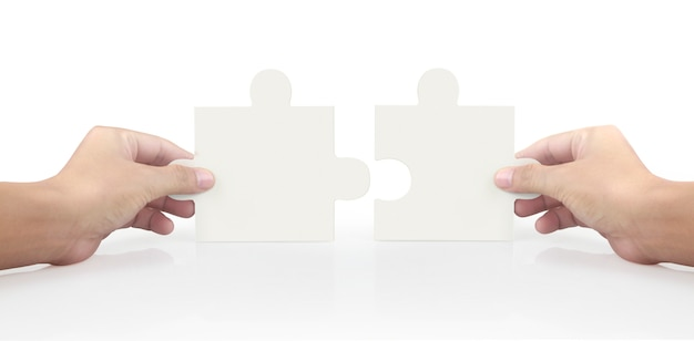 Hand of connecting jigsaw puzzle,concept of teamwork.