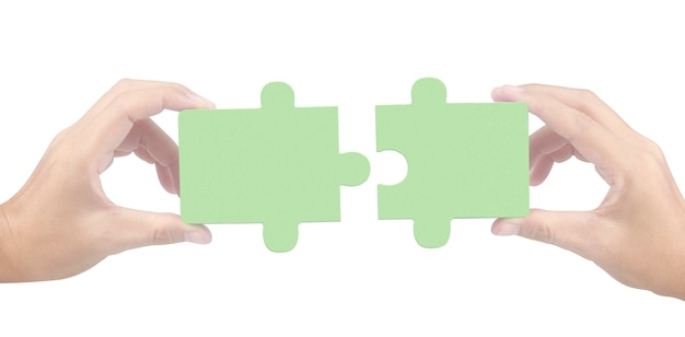 Hand of connecting jigsaw puzzle isolated