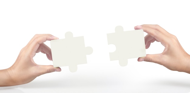 Hand of connecting jigsaw puzzle