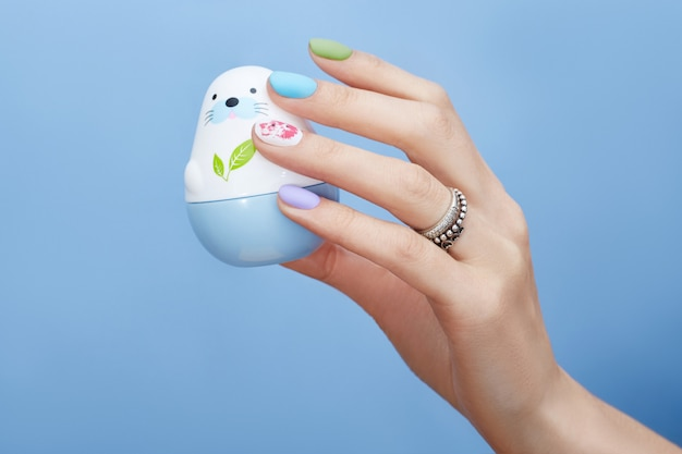 Hand cosmetics nails coloring and care, professional manicure and care product.