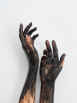 Hand covered in black paint