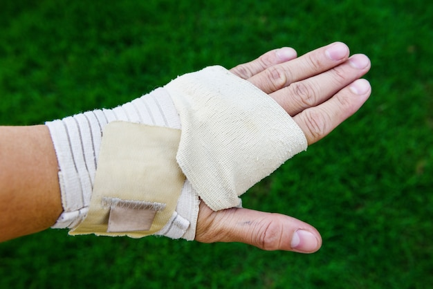 Hand covered by medical bandage