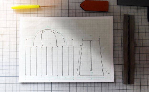 Hand craft bag disign concept sketch in paper and tools.