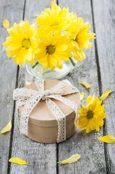 Hand crafted gift and yellow daisies