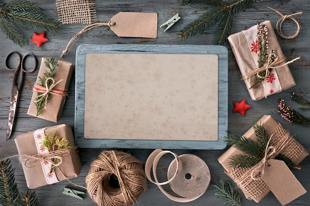 Hand crafted gifts on rustic wooden table with christmas decorations