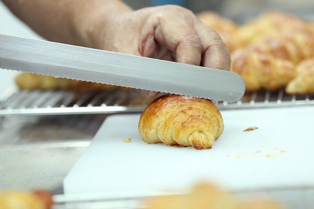 Hand cutting croissant