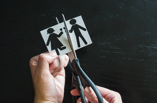 Hand cutting paper family with scissors