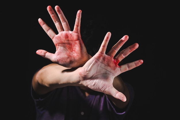 Hand defending victim of human trafficking for stop violence and abuse human trafficking harassment against rape