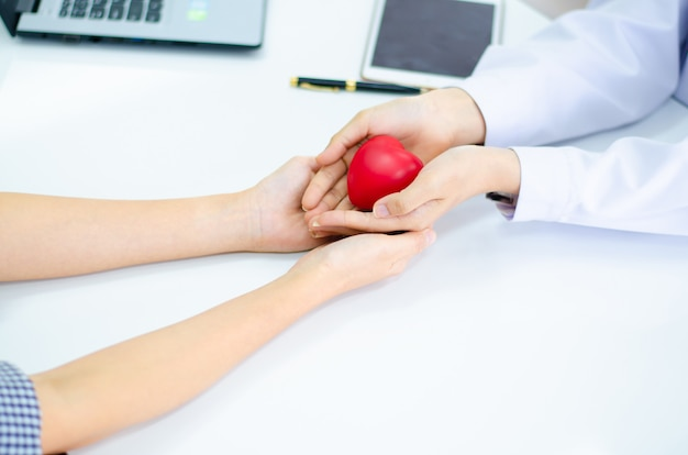 Hand of doctor give heart to people  hand