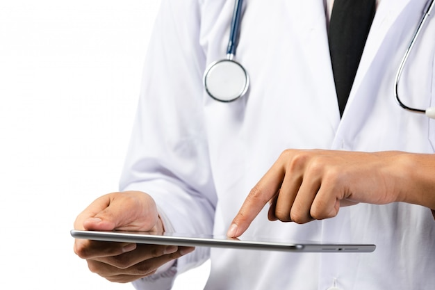 Hand of doctor using tablet computer with stethoscope .