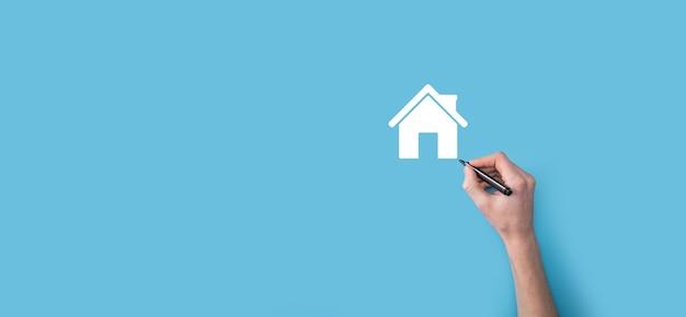 손 마커가있는 집 아이콘을 그립니다. 부동산 개념입니다. 재산 보험 및 보안 개념입니다. 혁신 기술 인터넷 네트워크 개념입니다.
