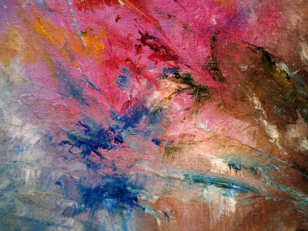 手は、カラフルな油絵マルチカラー抽象的な背景とテクスチャーを描きます。