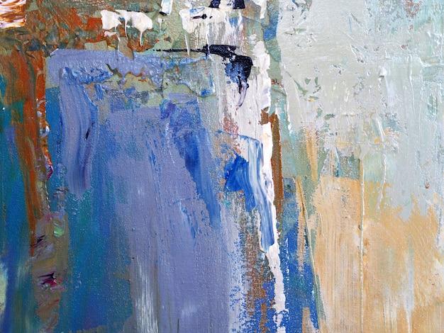 手はキャンバスに油絵ベージュ色ブラシストロークテクスチャ抽象的な背景を描きます。