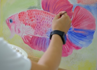 Hand drawing  beautiful red fighting fish on board fish from thailand.