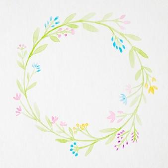 白い紙の背景に水彩のスタイルで花を描く手