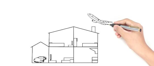 디자이너가 꿈의 집 그리기의 손 그리기 집 개념