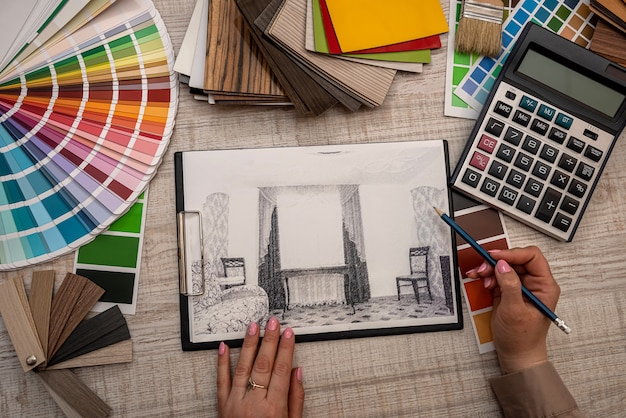 Hand drawing house sketch plan blue print and chooses color for business
