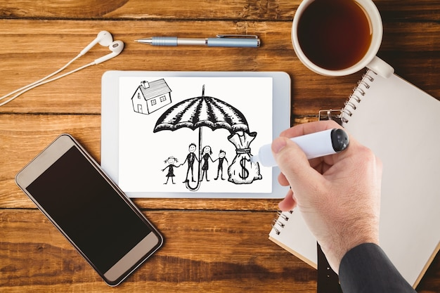 Hand drawing an umbrella on a tablet