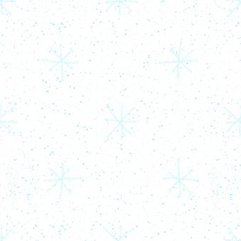 手描きの青い雪片のクリスマスのシームレスなパターン。白い背景の上の微妙な空飛ぶ雪片。かわいいチョークの手描きの雪のオーバーレイ。見事なホリデーシーズンの装飾。