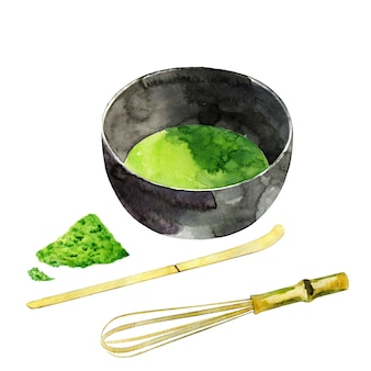 Ручной обращается чаша с бамбуковым венчиком матча и ложкой